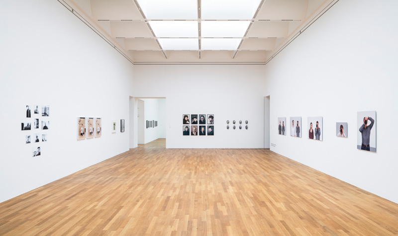 "Photographers masks of death & Schöne Frauen (center) next to works of Annette Kelm (left) and works by Dieter Kiessling (right) ""Mit anderen Augen"", installation view Kunstmuseum Bonn, 2016"